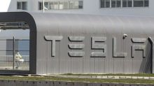 Tesla stock jumps above $900, biggest gain in two weeks