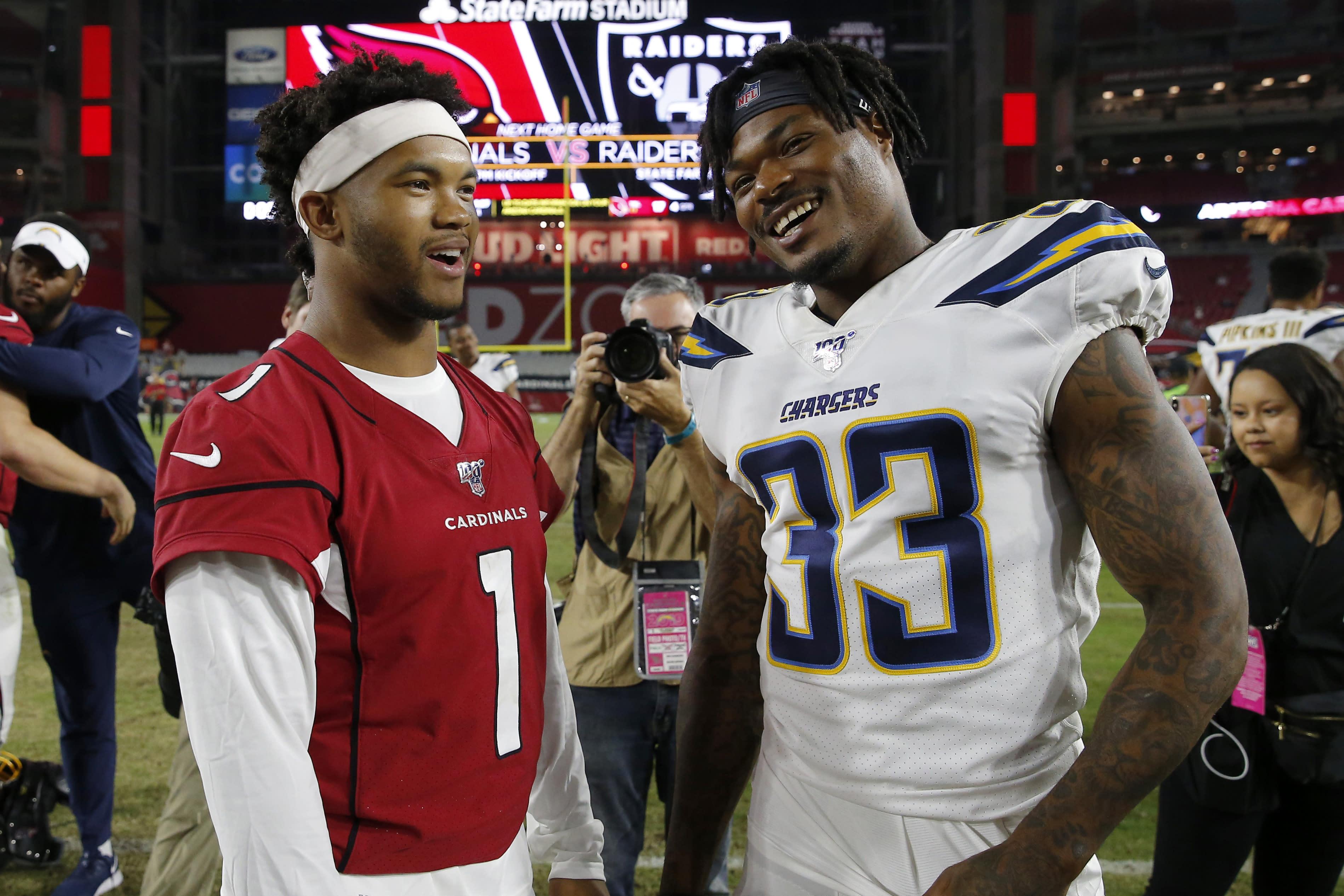 Arizona Cardinals quarterback Kyler Murray (1) greets Los Angeles Chargers free safety Derwin James (33) after an NFL preseason football game, Thursday, Aug. 8, 2019, in Glendale, Ariz. (AP Photo/Rick Scuteri)