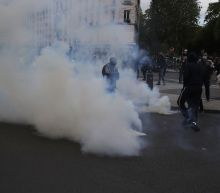 Police fire tear gas on banned Palestinian march in Paris