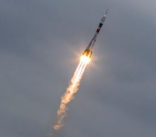 U.S.-Russian crew blasts off for space station