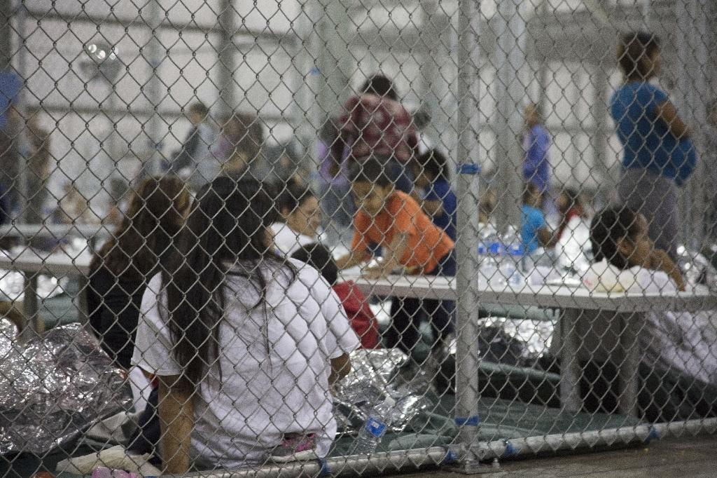 This US Customs and Border Protection photo dated June 17, 2018 shows intake of illegal border crossers by US Border Patrol agents at the Central Processing Center in McAllen, Texas