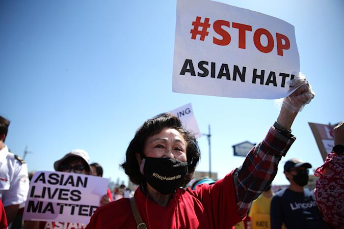 LOS ANGELES, CALIFORNIA - MARCH 27: People demonstrate at the 'Stop Asian Hate March and Rally' in Koreatown on March 27, 2021 in Los Angeles, California. March 27 is the #StopAsianHate  National Day of Action against anti-Asian violence. On March 16th, eight people were killed at three Atlanta-area spas, six of whom were Asian women, in an attack that sent fear through the Asian community amid a rise in anti-Asian hate crimes. (Photo by Mario Tama/Getty Images)