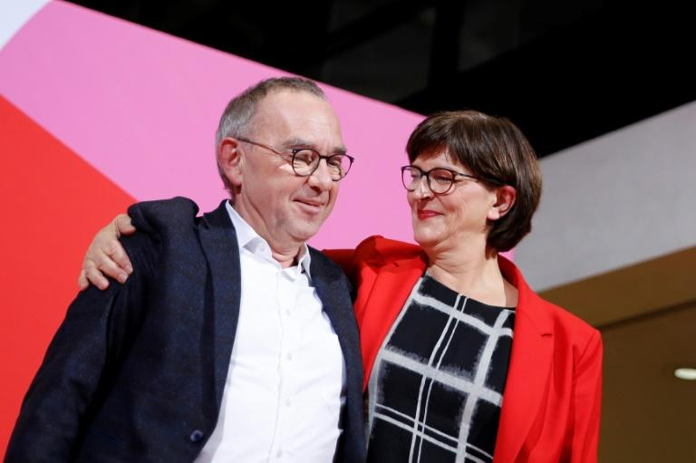 Incoming SPD leaders Norbert Walter-Borjans and Saskia Esken are critical of Merkel's grand right-left coalition