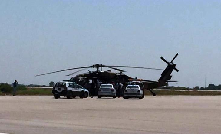 Greek police vehicles encircle a Turkish military helicopter at Alexandroupolis airport on July 16, 2016 after it landed carrying eight officers seeking asylum after a coup bid in Turkey