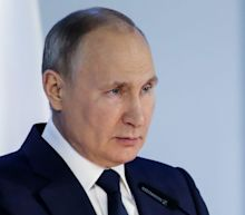 Putin warns that anyone who threatens Russia's security will 'regret' it as he amasses 100,000 troops on Ukraine's borders