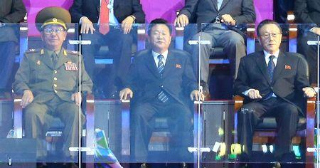 Hwang Pyong So (L-R), director of the North Korean army's General Political Bureau, Choe Ryong Hae, a secretary of the central committee of the Workers' Party of North Korea, and Kim Yang Gon, director of the United Front Department of the ruling Workers' Party of North Korea, attend the closing ceremony of the 17th Asian Games at the Incheon Asiad Main Stadium October 4, 2014. REUTERS/Hwang Gwang-mo/Yonhap
