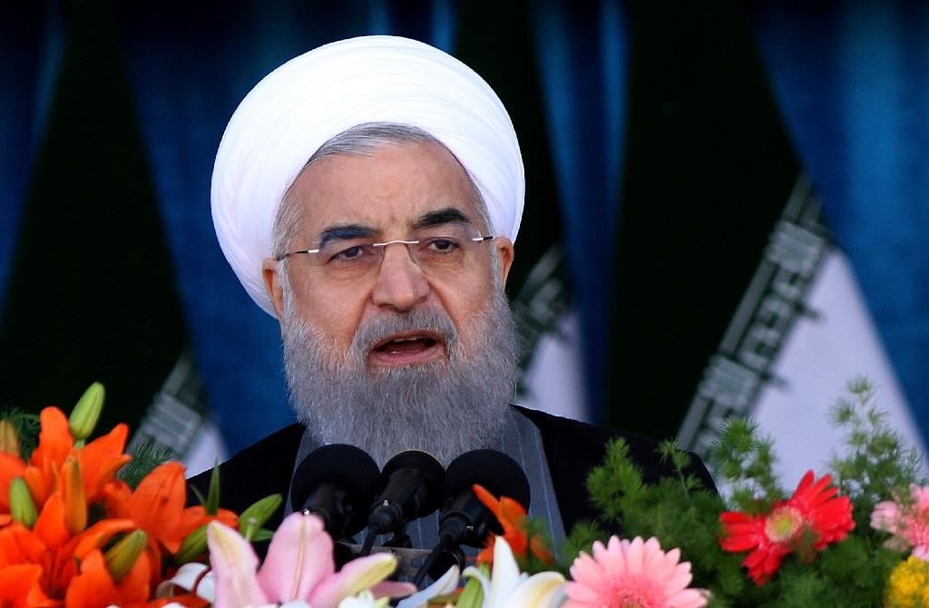 President Hassan Rouhani faces a tough battle for re-election on May 19 as conservative opponents attack his failure to revive Iran's stagnant economy (AFP Photo/Atta KENARE)