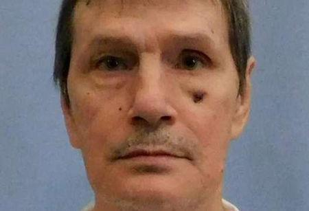 Death row inmate Hamm appears in a police booking photo