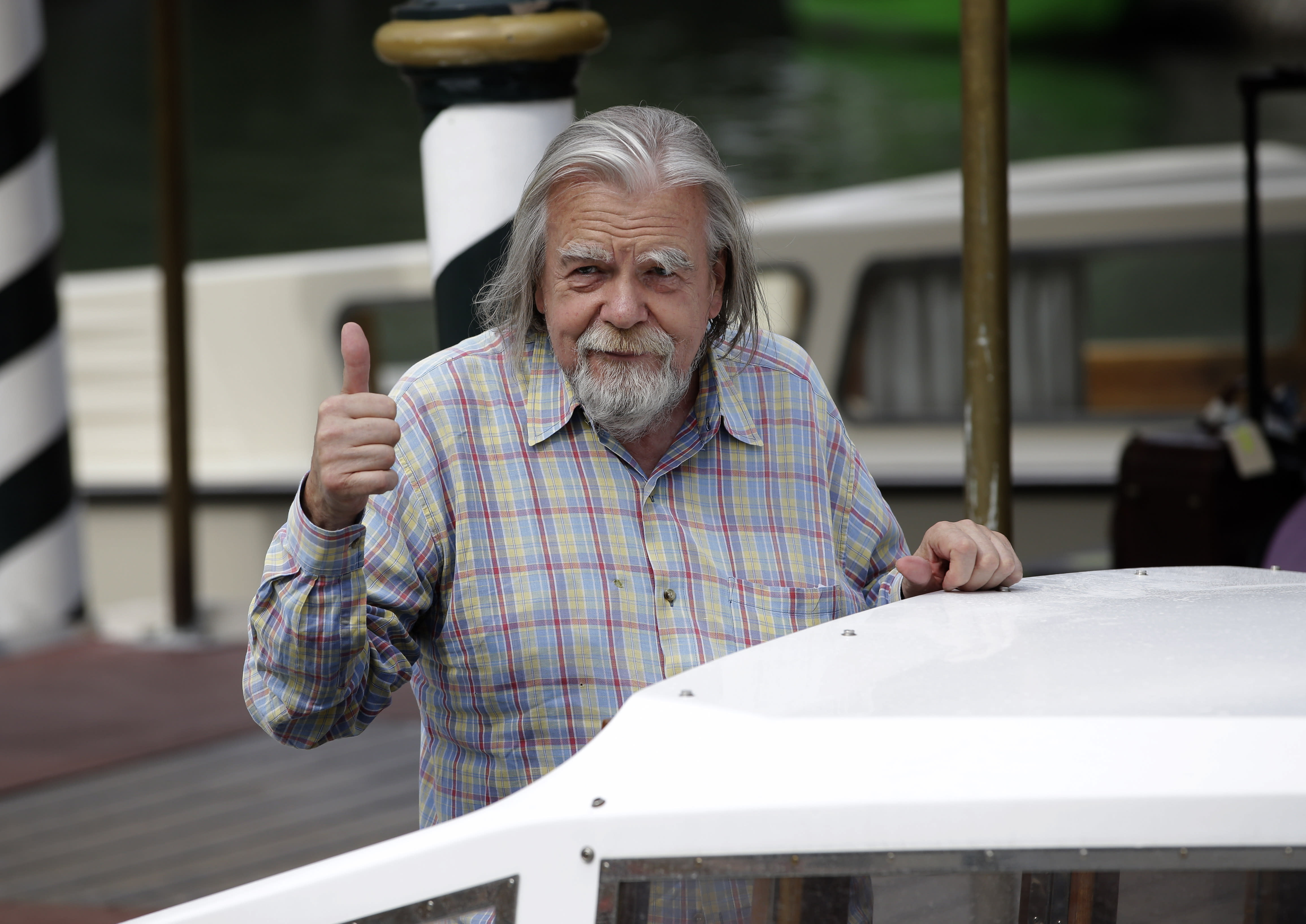"FILE - In n this Sept.4, 2012 file photo, actor Michael Lonsdale arrives at the 69th edition of the Venice Film Festival in Venice, Italy. Michael Lonsdale, a French-British actor and giant of the silver screen and theatre in France, died on Monday, his agent said. From his role as villain in the 1979 James Bond film ""Moonraker"" to that of a monk in Algeria in ""Of Gods and Men,"" Lonsdale worked, often in second roles, with top directors from Orson Wells to Spielberg.(AP Photo/Andrew Medichini, File)"