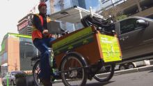 Solar-powered trikes watering plants along Edmonton's downtown bike lanes