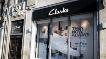 Shoe firm Clarks plans 900 job cuts with some stores shut for good