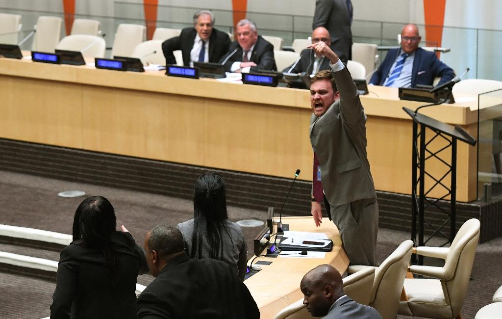 """Cuban diplomats, pictured protesting at the United Nations, demanded an end to the """"blockade of Cuba."""" (AFP Photo/TIMOTHY A. CLARY)"""