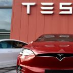 Tesla settles Michigan lawsuit over delivering and selling cars