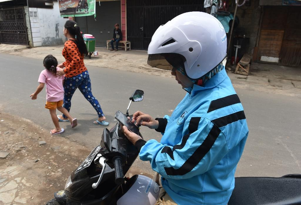 Several motorbike taxi services with women drivers entered the Indonesian market in 2015 after years of growing piety in the country