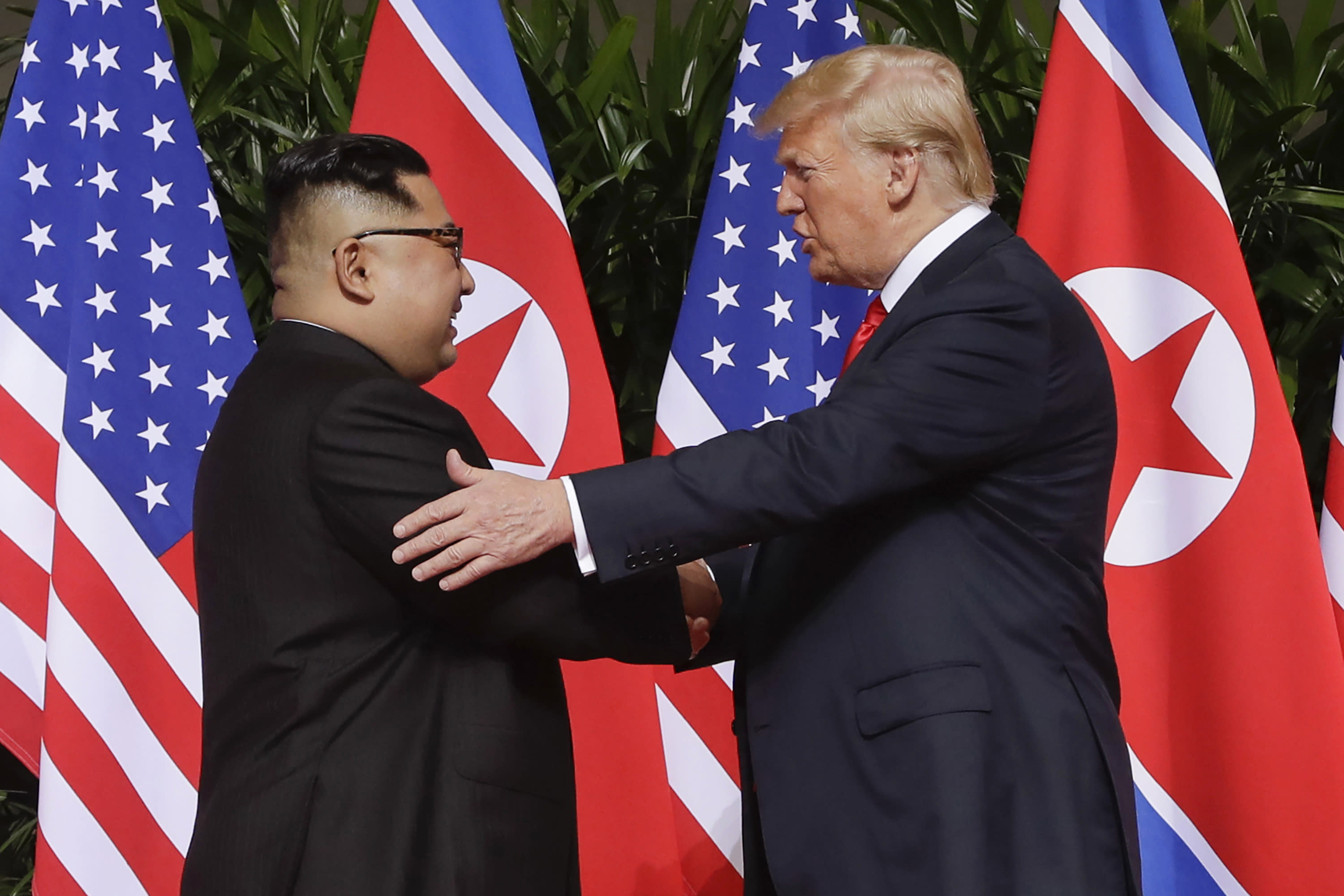 FILE - In this June 12, 2018, file photo, U.S. President Donald Trump, right, shakes hands with North Korea leader Kim Jong Un at the Capella resort on Sentosa Island in Singapore. U.S. Secretary of State Mike Pompeo downplayed the possibility of another summit between President Donald Trump and North Korean leader Kim Jong Un before the U.S. presidential election, saying Trump would only want to engage if there were real prospects of progress. (AP Photo/Evan Vucci, File)