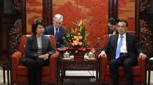 China urges US to avoid damaging business confidence