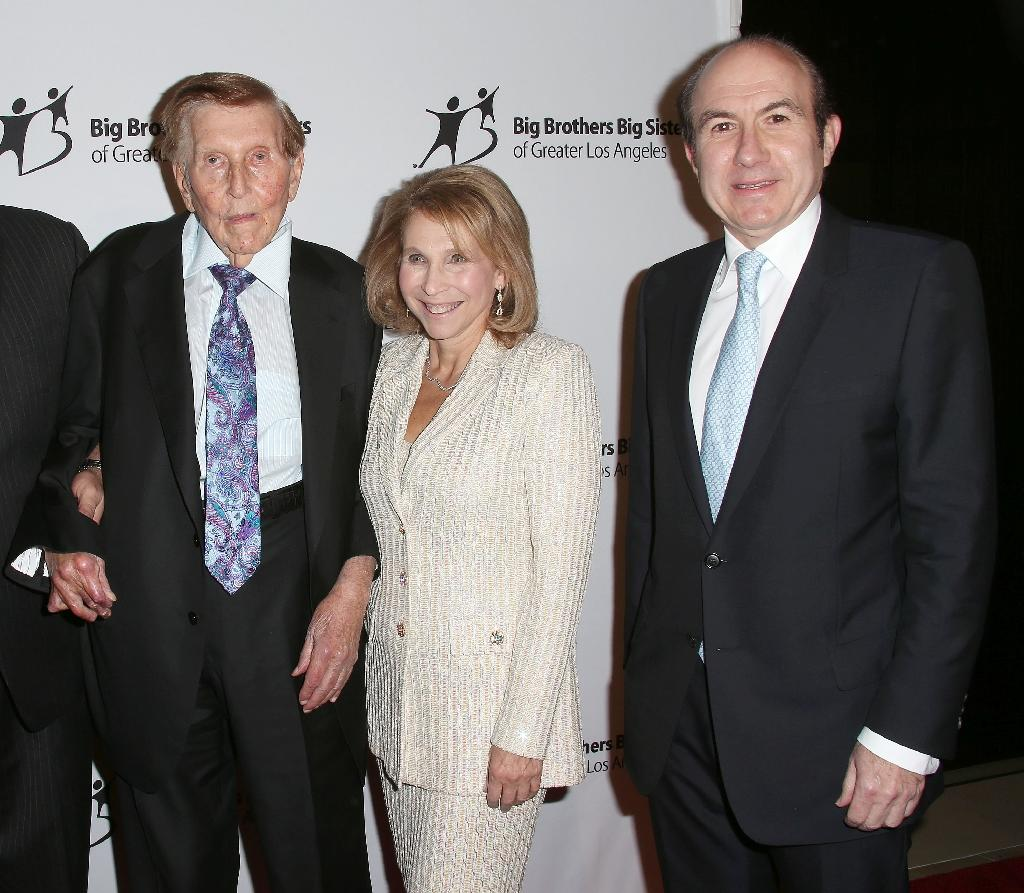 A 2012 photo shows Shari Redstone, at center, who has been acting on behalf of her ailing father Sumner Redstone at the media-entertainment empire including CBS and Viacom. At right is former Viacom CEO Philippe Dauman