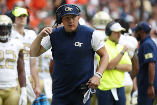 FILE - In this Saturday, Oct. 19, 2019, file photo, Georgia Tech head coach Geoff Collins is shown during the first half of an NCAA college football game against Miami, in Miami Gardens, Fla. Collins said his field goal unit normally runs eight live repetitions twice a week at practice, but he shortened those drills in a nod to social distancing amid the coronavirus pandemic. (AP Photo/Wilfredo Lee, File)