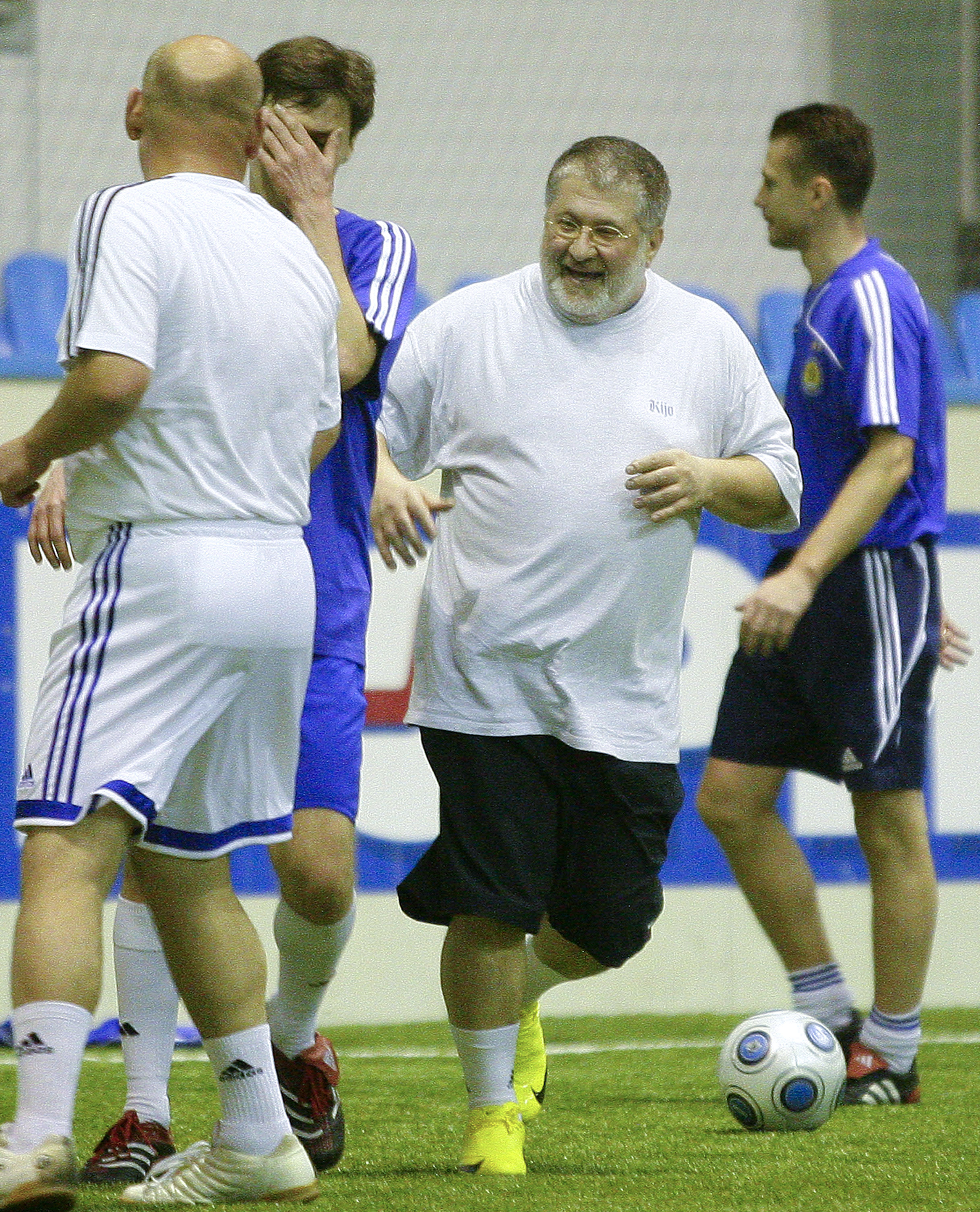 In this photo taken in Feb. 26, 2010, Ukrainian oligarch Igor Kolomoyskiy, center, plays soccer in Kiev, Ukraine. For years, Ukraine's business tycoons have challenged the central authorities in Kiev, fighting, plotting and scheming to enlarge and maintain their multimillion-dollar empires. But when President Vladimir Putin's troops invaded the pro-Russian strategic Black Sea peninsula of Crimea and held massive military exercises near the border with eastern Ukraine, the country's richest men put their rivalries aside, rallied behind the new government in Kiev and took up governors' posts in the east of the country to counter possible Russian aggression there. (AP Photo/Andriy Lukatsky)