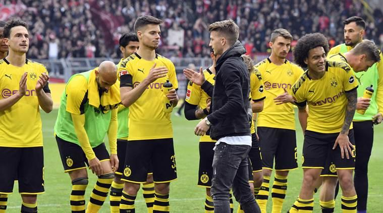 Borussia Dortmund hopes for 'small miracle' to take title from Bayern Munich