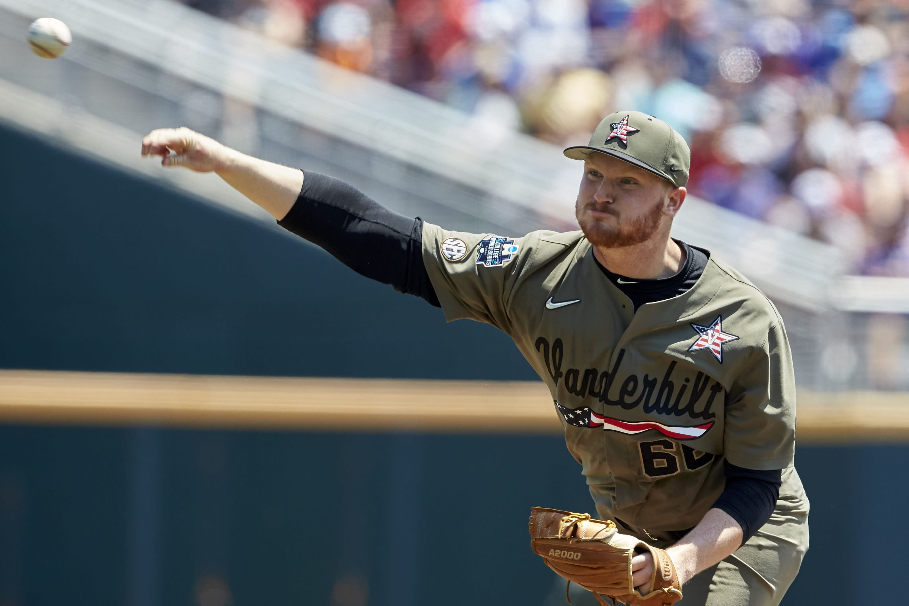 Martin hits 2 HRs, Vanderbilt beat Louisville 3-1 in CWS
