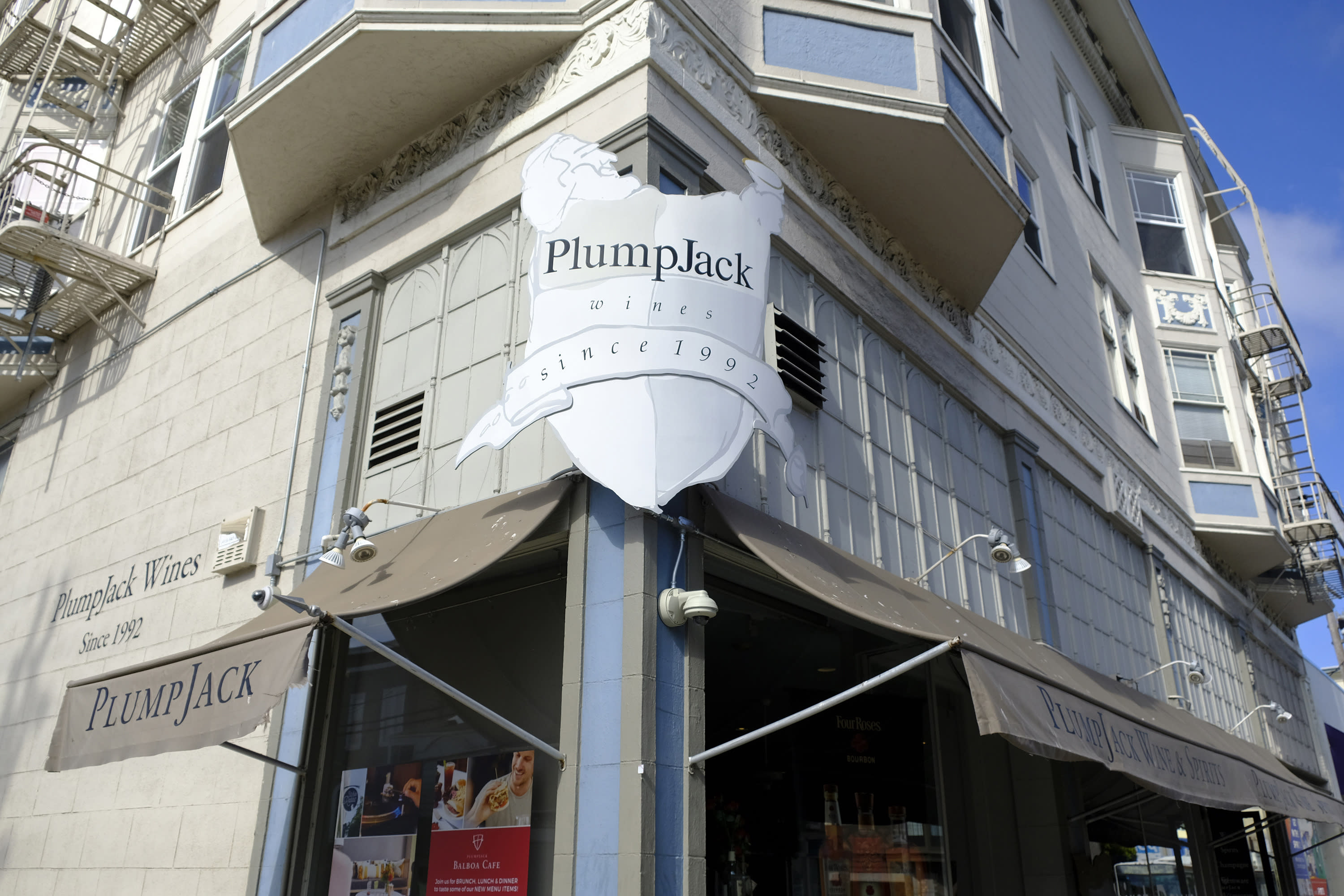 FILE - This Monday, Oct. 22, 2018, file photo shows the Plumpjack Wine & Spirits store in San Francisco, part of the Plumpjack Group collection of wineries, bars, restaurants, hotels and liquors stores. Governors, like California Gov. Gavin Newsom, who implemented shutdowns as their states responded to the coronavirus pandemic were among millions of beneficiaries of the loan program created to help small businesses, data released Monday, July 6, 2020 show. PlumpJack Management Group, LLC, Newsom's winery and hospitality company he founded, received a loan worth $150,000 to $350,000. (AP Photo/Eric Risberg, File)