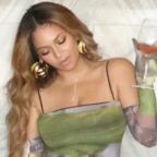 Beyoncé Wore a Trippy Green Bodycon Mini Dress and Gloves for a Date Night With Jay-Z