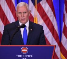 Pence defends Trump in spat with US civil rights icon