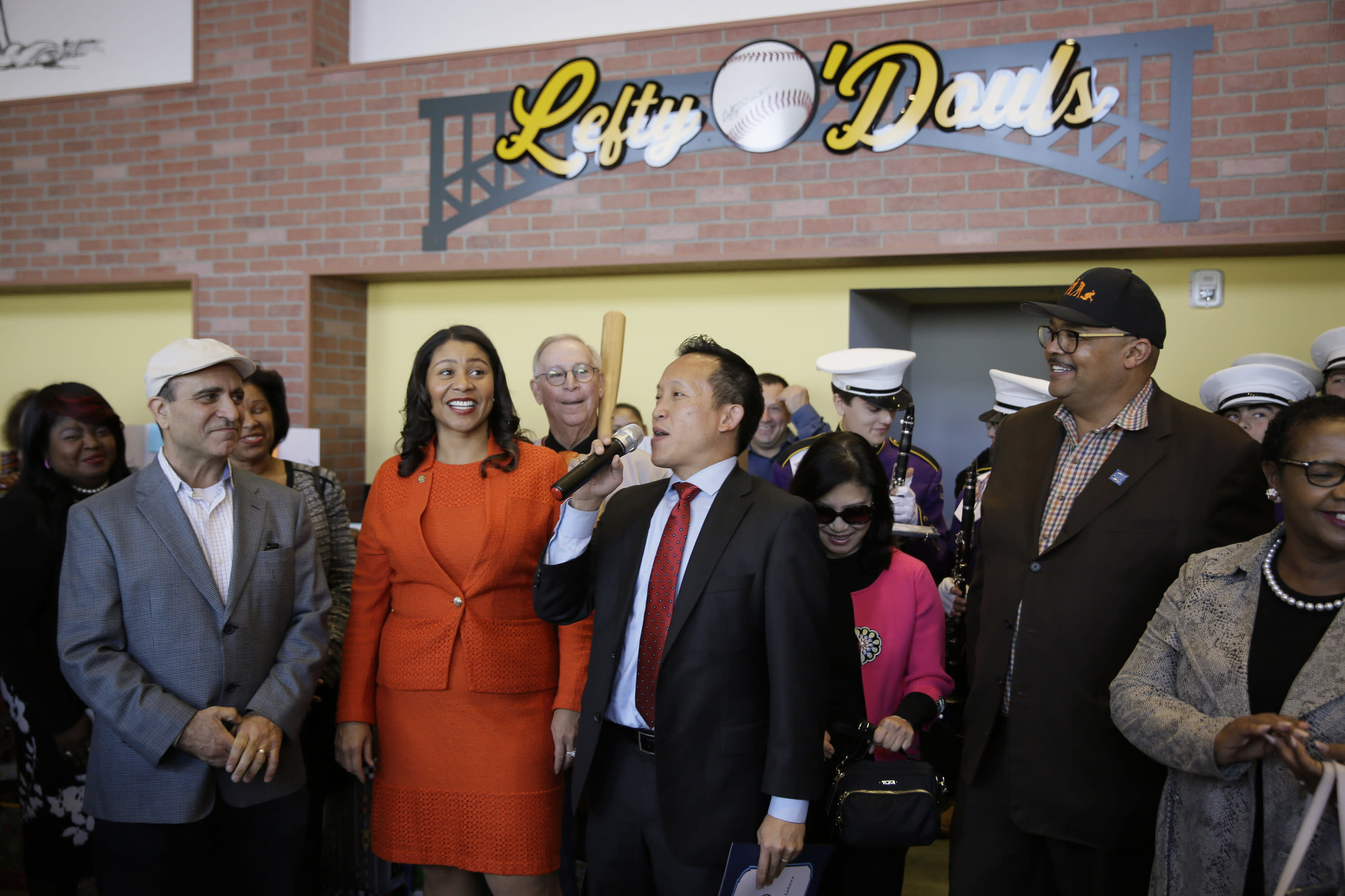 FILE - In this Nov. 20, 2018, file photo, from left, owner Nick Bovis, San Francisco Mayor London Breed, state assemblyman David Chiu speaking and city public works director Mohammed Nuru take part in the opening ceremonies of Lefty O'Doul's Baseball Ballpark Buffet & Café at Fisherman's Wharf in San Francisco. A top San Francisco official in charge of cleaning up the city's notoriously filthy streets and a champion of adding more portable toilets has been arrested, jail records show. Nuru was taken into custody Monday, Jan. 27, 2020, along with Bovis, the owner of Lefty O'Doul's, a longtime sports bar popular with tourists. Records say only that the men were arrested for felony safekeeping, which typically indicates federal charges. (AP Photo/Eric Risberg)