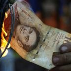 Venezuela lops five zeros off its currency in bid to tackle hyperinflation