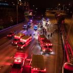 A vehicle drove through a crowd of protesters on a closed Seattle freeway, leaving one woman dead and another in critical condition