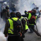 Emmanuel Macron Puts on His Yellow Vest