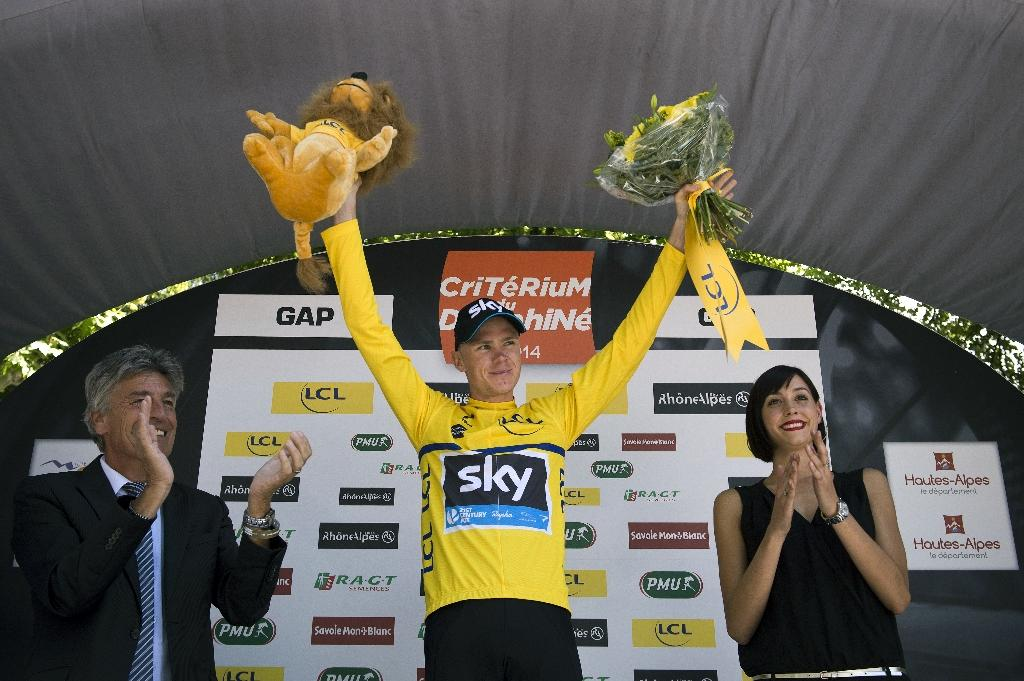 Britain's Chris Froome celebrates on the podium after the fourth stage (Montelimar - Gap) of the 66th Dauphine Criterium cycling race on June 11, 2014 in Gap (AFP Photo/Lionel Bonaventure)