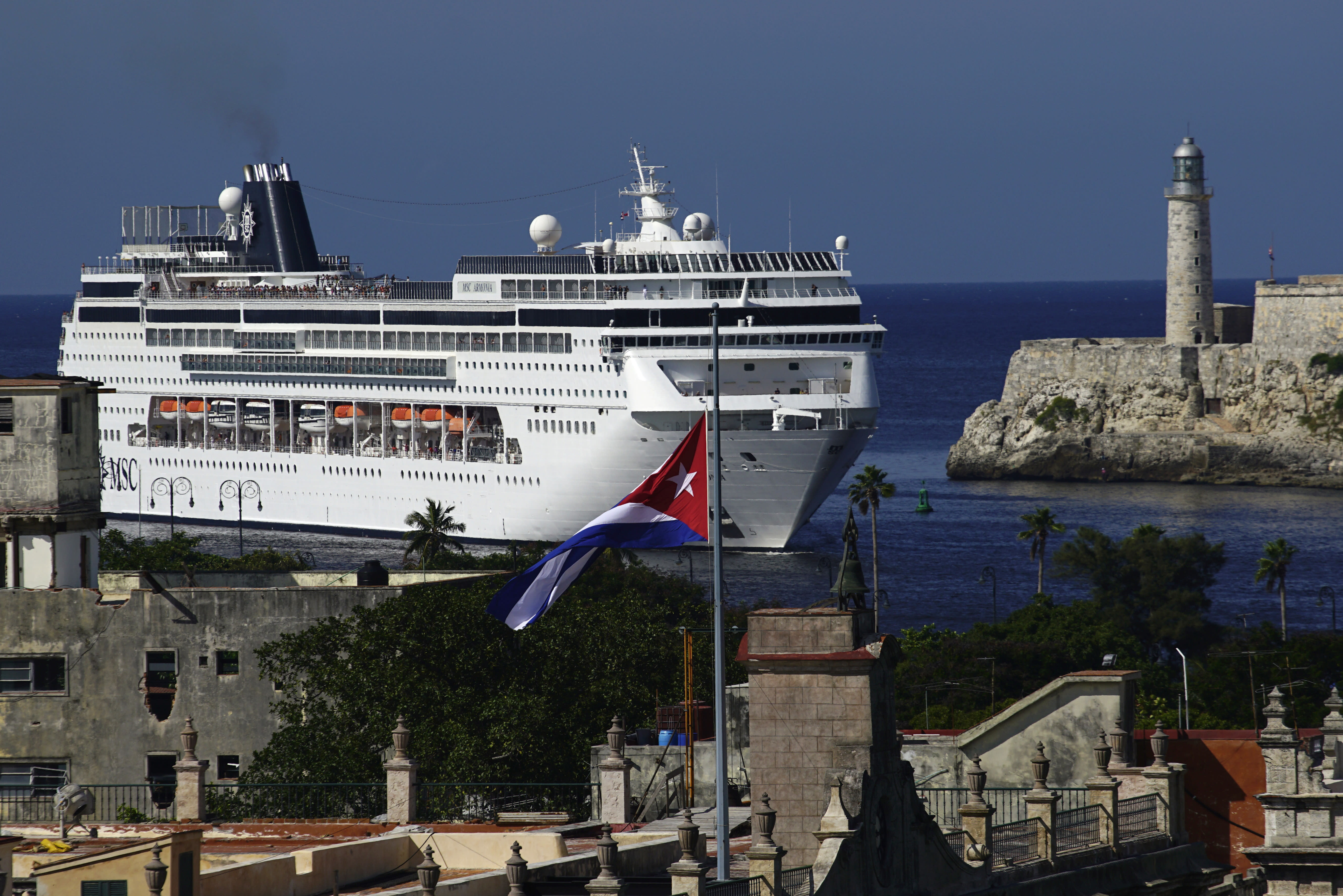 FILE - In this Nov. 29, 2016 file photo, a cruise ship enters the port in Havana, Cuba. Heirs of families that owned ports which are now being used to dock cruise ships that began traveling to Cuba in 2016 under President Barack Obama's detente with the island, filed the first lawsuits on Thursday, May 2, 2019, against European and American companies doing business on confiscated properties in Cuba. (AP Photo/Ramon Espinosa, File)