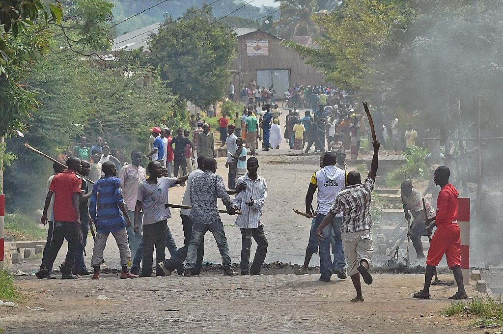 A protester opposed to the Burundi President Pierre Nkurunziza's third term is snatched by members of the 'Imbonerakure', the youth wing of the ruling party, in Bujumbura on May 25, 2015