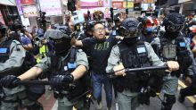 Hong Kong protests: two charged over Sunday's demonstrations against national security law