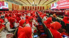 Don't bite the hand that fed you, Puteri Umno delegate tells Malay community