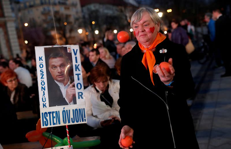 FILE PHOTO: Supporter of Fidesz party reacts after first exit polls of Hungarian election in Budapest