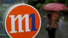 Exclusive: Axiata likely to reject Keppel-led offer for Singapore mobile firm M1 - source