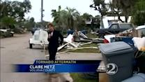 Resident works to clean up after Volusia County tornado