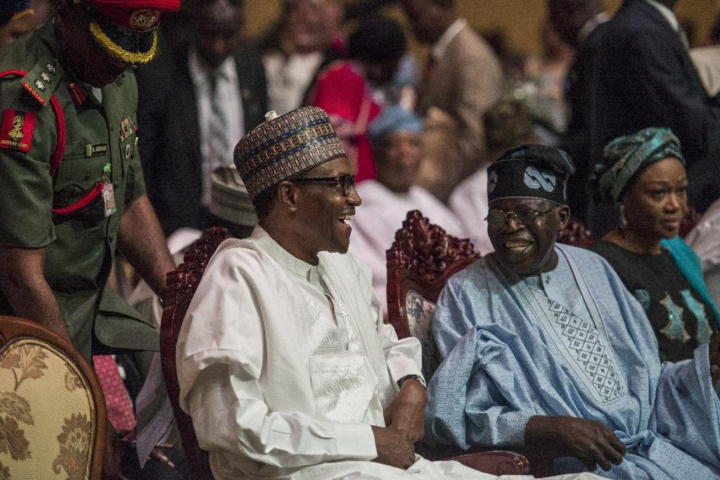 Buhari and Tinubu were all smiles in front of the cameras (AFP Photo/STEFAN HEUNIS)