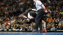 Wrestler wins championship, body-slams coach in celebration