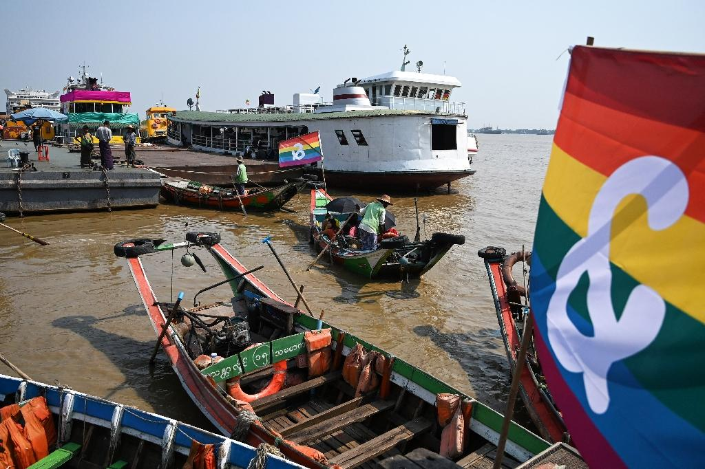 Wooden boats displayed LGBT rainbow flags during the Pride Boat Parade, part of the Yangon Pride festival (AFP Photo/YE AUNG THU)