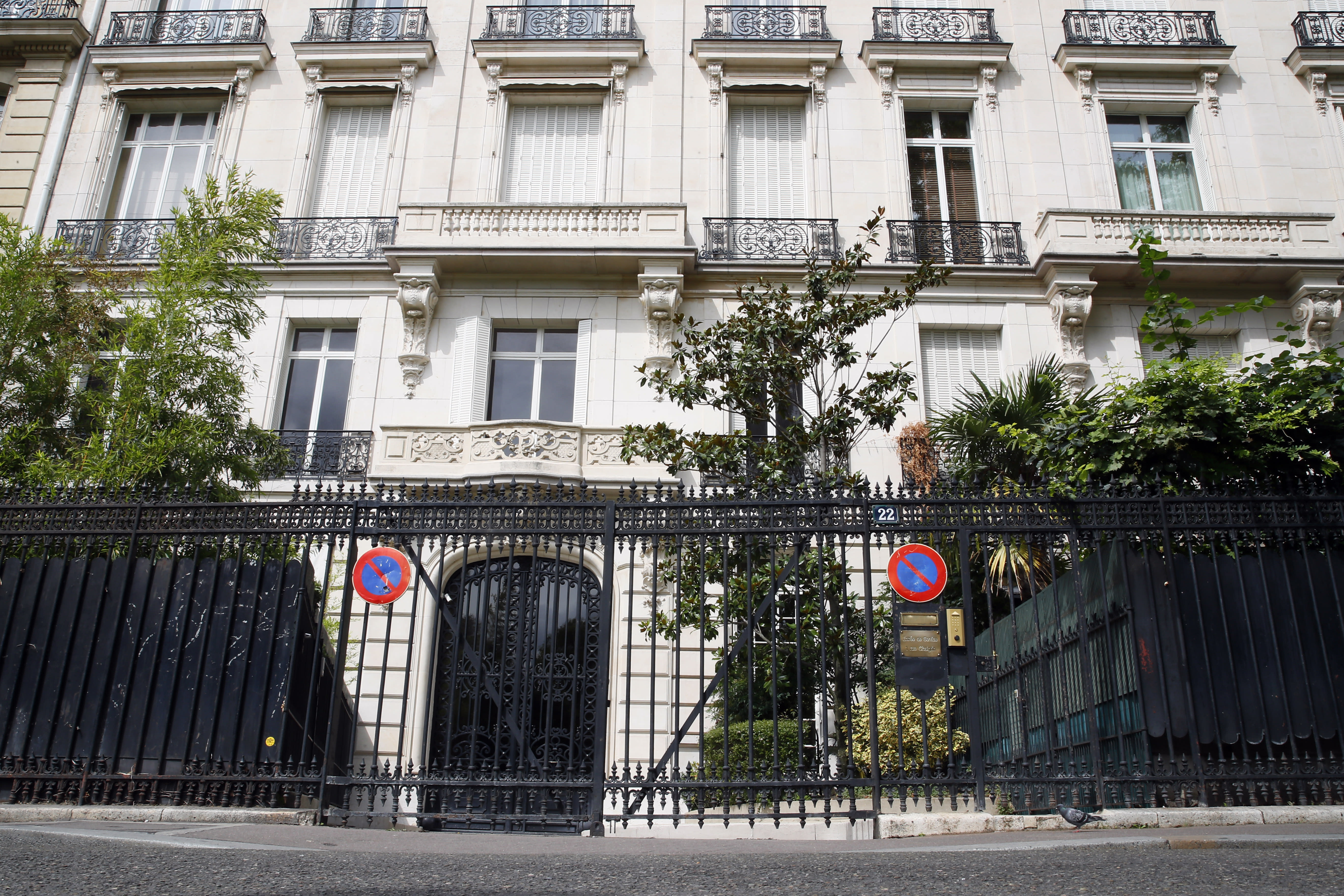 The entrance of an apartment building owned by Jeffrey Epstein in the 16th district in Paris, Tuesday, Aug. 13, 2019. France's government wants prosecutors to open an investigation into Jeffrey Epstein's links to France following his death in a Manhattan jail cell. U.S. authorities say Epstein had a residence in Paris and used a fake Austrian passport to travel to France in the 1980s. (AP Photo/Francois Mori)