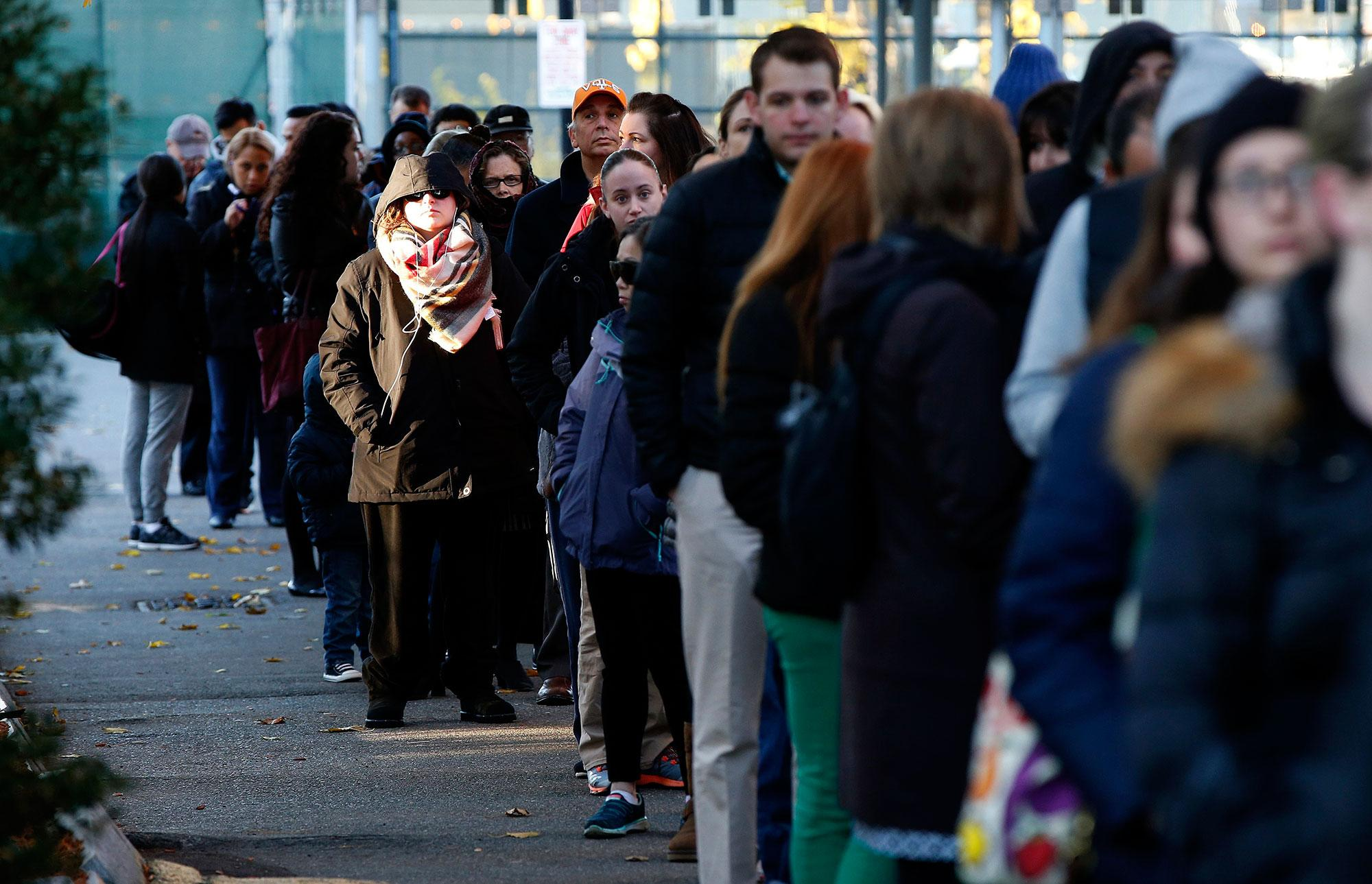 <p>People line up to vote in the East Boston neighborhood of Boston, Tuesday, Nov. 7, 2016. (Photo: Michael Dwyer/AP) </p>