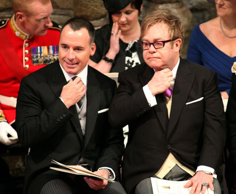 David Furnish (left) and Elton John at the wedding of Britain's Prince William and Kate Middleton, at Westminster Abbey in central London, on April 29, 2011 (AFP Photo/Jon Bond)