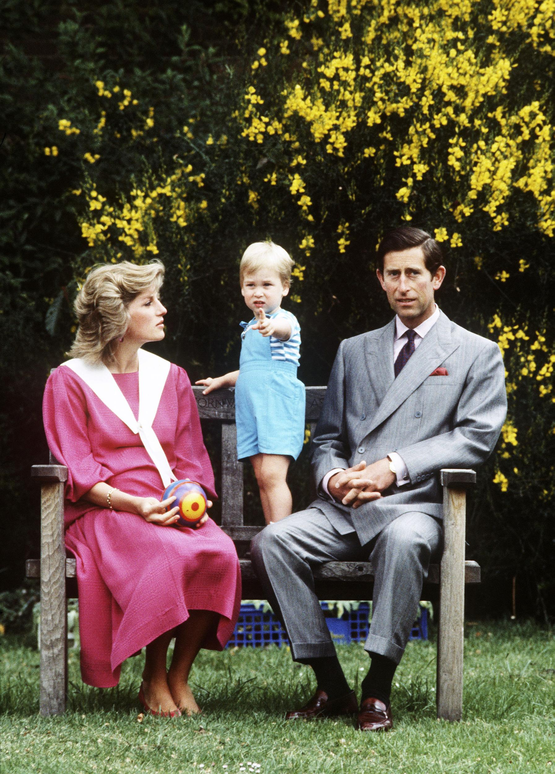 LONDON - JUNE 12:  Prince Charles and Princess Diana pose with their son, Prince William, for his second birthday (born 21 June 1982) in their garden at their Kensington Palace home June 12, 1984 in London, England.  (Photo by Anwar Hussein/WireImage)