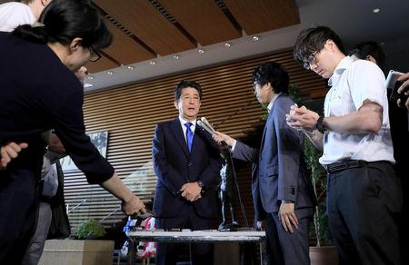 Japan's Prime Minister Shinzo Abe speaks to reporters after a powerful earthquake hit Japan's northern island of Hokkaido, at Abe's official residence in Tokyo, Japan in this photo taken by Kyodo September 6, 2018. Mandatory credit Kyodo/via REUTERS