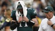 Wentz ruled out with knee injury after hard hit