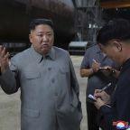 Kim inspects new sub, wants North Korea's military bolstered